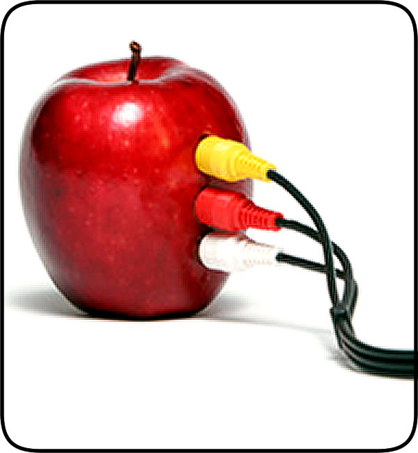 An apple with speaker electronic connections attached